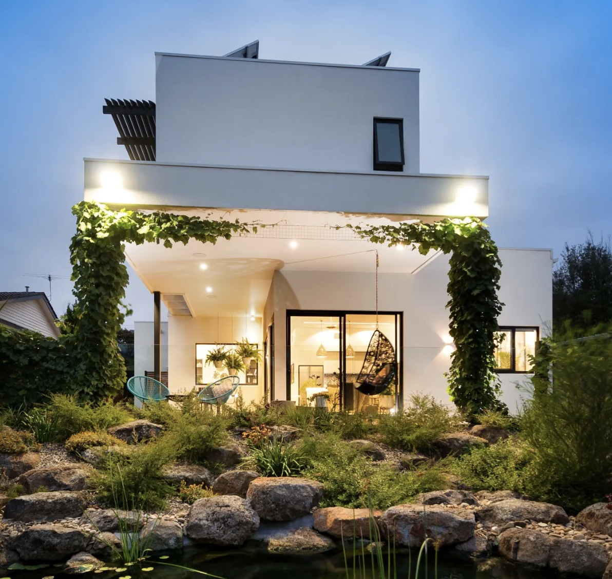 The Australian eco friendly white pebble house with its own billabong.