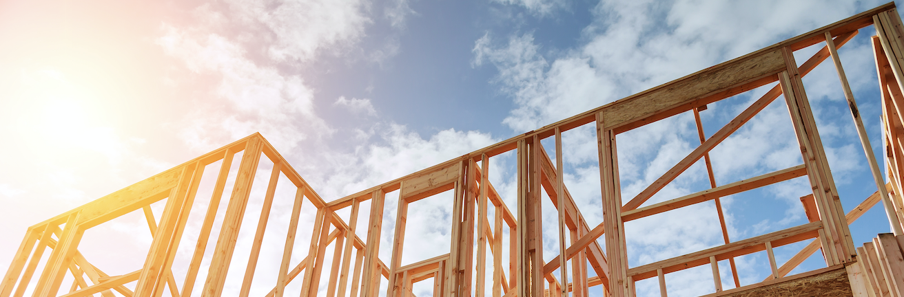 The wooden framework of a new home being constructed.