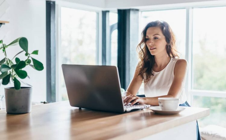 A lady working from home looking up possible home loans.