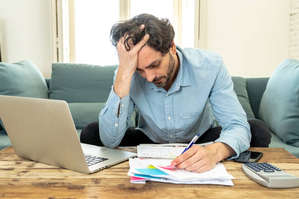 A person struggling to get their personal debt in order.