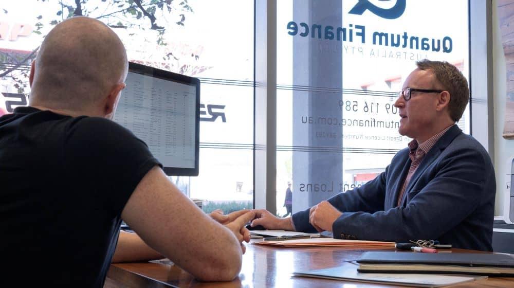 Gavin Hariggan with client, Quantum Finance